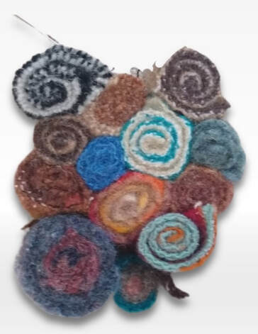 quillie rag rug start. several beads for a standing wool rug