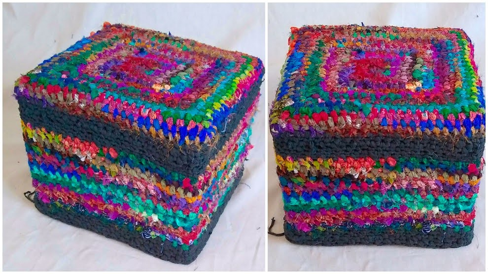 Plastic milk crate that has a slipcover on it made from t shirt yarn and recycled sari silk ribbon. top and side view